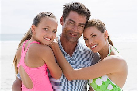 Parents and young daughter at the beach Stock Photo - Premium Royalty-Free, Code: 6114-06596083