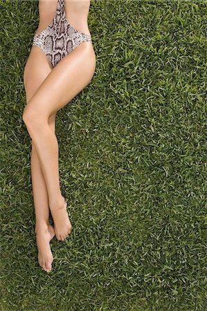 Legs of woman in bathing costume Stock Photo - Premium Royalty-Free, Code: 6114-06596229