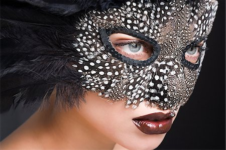 Woman wearing mask of feathers Stock Photo - Premium Royalty-Free, Code: 6114-06596475