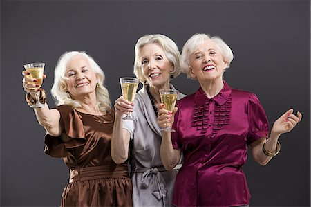 Senior female friends toasting with champagne Stock Photo - Premium Royalty-Free, Code: 6114-06596650
