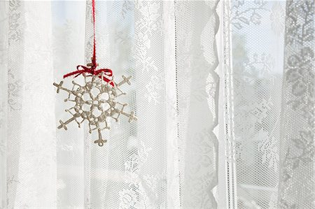 snowflakes  holiday - Snowflake decoration in window Stock Photo - Premium Royalty-Free, Code: 6114-06596745