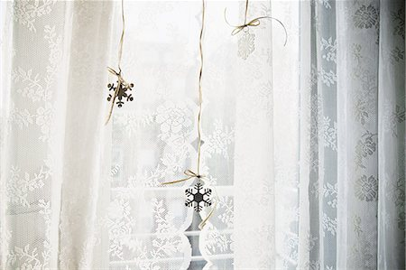 snowflakes  holiday - Snowflake decorations in window Stock Photo - Premium Royalty-Free, Code: 6114-06596749