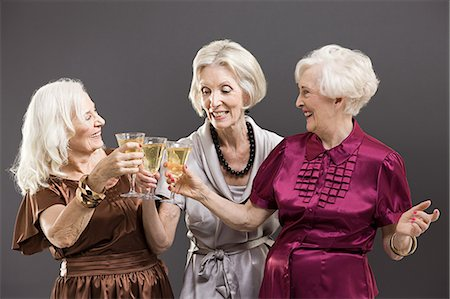 Senior female friends toasting with champagne Stock Photo - Premium Royalty-Free, Code: 6114-06596704