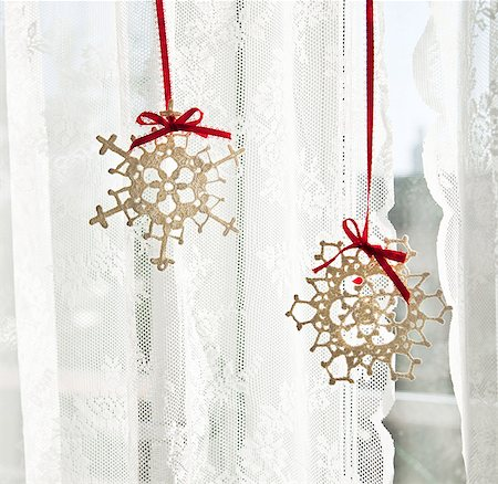 snowflakes  holiday - Snowflake decorations in window Stock Photo - Premium Royalty-Free, Code: 6114-06596708