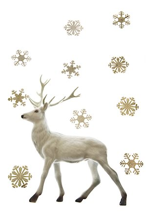 reindeer in snow - Reindeer figurine and snowflakes Stock Photo - Premium Royalty-Free, Code: 6114-06596712