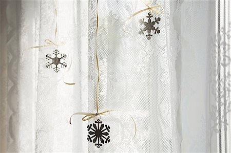 snowflakes  holiday - Snowflake decorations in window Stock Photo - Premium Royalty-Free, Code: 6114-06596728