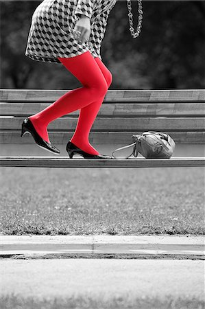 Woman on bench with red tights Stock Photo - Premium Royalty-Free, Code: 6114-06596840