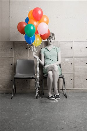 Teenage girl holding bunch of balloons Stock Photo - Premium Royalty-Free, Code: 6114-06596855