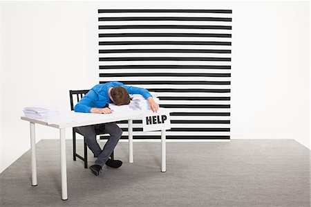people in panic - Office worker with sign that says help Stock Photo - Premium Royalty-Free, Code: 6114-06597047