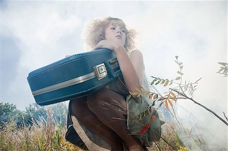 Girl with a suitcase Stock Photo - Premium Royalty-Free, Code: 6114-06597093