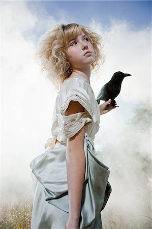 Girl with a crow Stock Photo - Premium Royalty-Free, Code: 6114-06597095