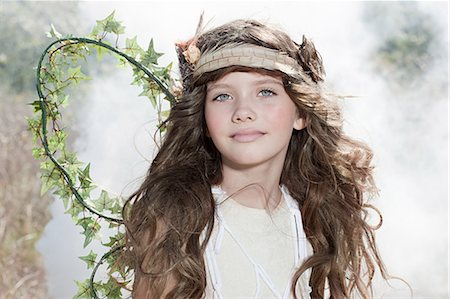Girl dressed as a fairy Stock Photo - Premium Royalty-Free, Code: 6114-06597101