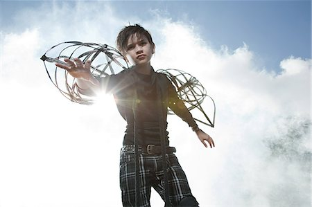 Boy wearing unusual costume Stock Photo - Premium Royalty-Free, Code: 6114-06597108