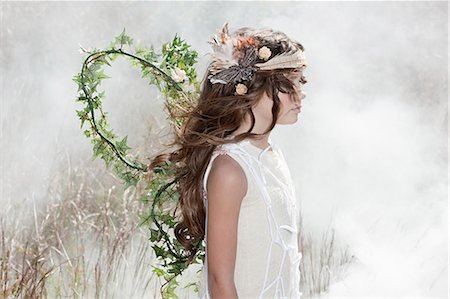 Girl dressed as a fairy Stock Photo - Premium Royalty-Free, Code: 6114-06597113
