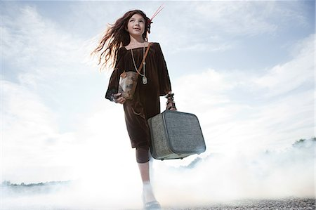 Girl with a suitcase Stock Photo - Premium Royalty-Free, Code: 6114-06597112