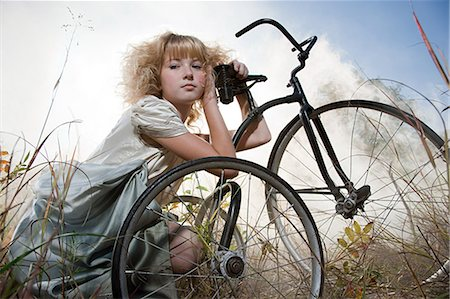 Girl with a bicycle Stock Photo - Premium Royalty-Free, Code: 6114-06597116