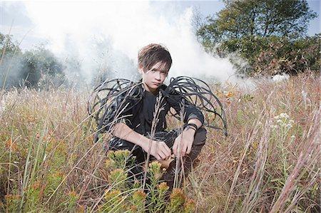 Boy wearing unusual costume Stock Photo - Premium Royalty-Free, Code: 6114-06597119