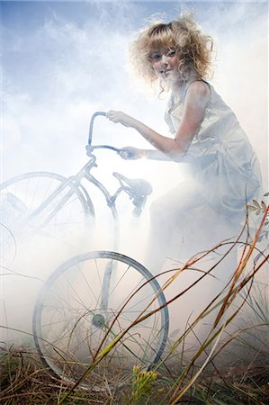 Girl with a bicycle Stock Photo - Premium Royalty-Free, Code: 6114-06597127