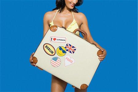 Woman holding suitcase Stock Photo - Premium Royalty-Free, Code: 6114-06597399