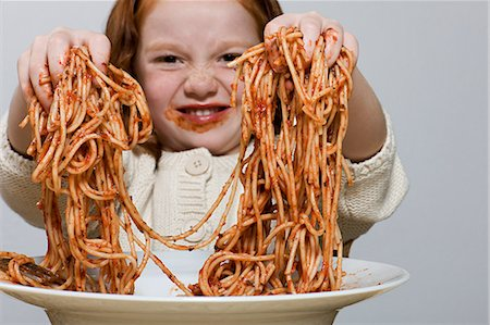 Girl holding spaghetti Stock Photo - Premium Royalty-Free, Code: 6114-06597711