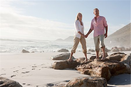 Couple standing on rocks on beach Stock Photo - Premium Royalty-Free, Code: 6114-06598108