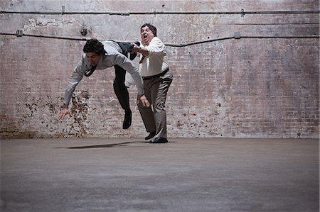 people falling - People fighting in warehouse Stock Photo - Premium Royalty-Free, Code: 6114-06598282