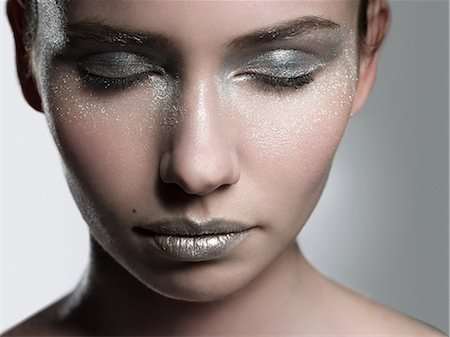 shimmering - Young woman with silver make up on face Stock Photo - Premium Royalty-Free, Code: 6114-06598380