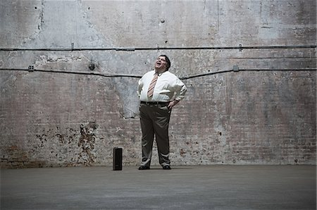 fat man full body - Man standing in warehouse Stock Photo - Premium Royalty-Free, Code: 6114-06598328