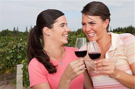 Women with red wine in vineyard Stock Photo - Premium Royalty-Free, Code: 6114-06598496