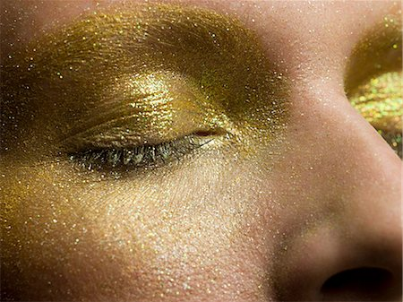 shimmering - Female eyes covered in gold make up Stock Photo - Premium Royalty-Free, Code: 6114-06598400