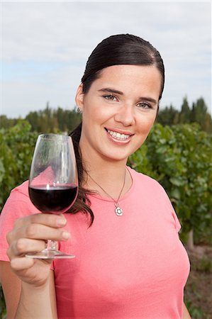 Woman in vineyard with red wine Stock Photo - Premium Royalty-Free, Code: 6114-06598541