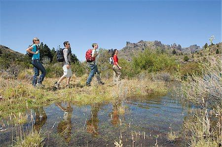 south american woman - Hikers walking by lake Stock Photo - Premium Royalty-Free, Code: 6114-06598590