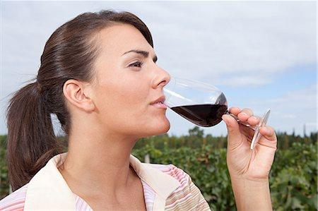 Woman drinking wine in vineyard Stock Photo - Premium Royalty-Free, Code: 6114-06598530