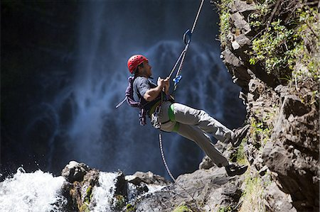 rock climber - Man abseiling by waterfall Stock Photo - Premium Royalty-Free, Code: 6114-06598694