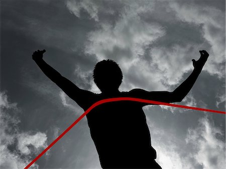 finish line - Silhouette of athlete at finish line Stock Photo - Premium Royalty-Free, Code: 6114-06598764