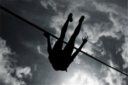 silhouette black and white - Silhouette of high jumper Stock Photo - Premium Royalty-Free, Code: 6114-06598772