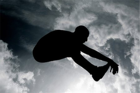 silhouette black and white - Silhouette of long jumper Stock Photo - Premium Royalty-Free, Code: 6114-06598778
