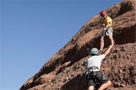 Two men rock climbing Stock Photo - Premium Royalty-Free, Code: 6114-06598706