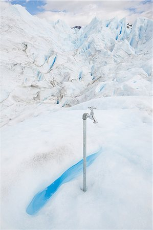 perito moreno glacier - Faucet at a glacier Stock Photo - Premium Royalty-Free, Code: 6114-06598957