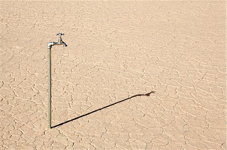 dry - Faucet in desert landscape Stock Photo - Premium Royalty-Free, Code: 6114-06598986