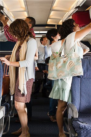 Passengers boarding a plane Stock Photo - Premium Royalty-Free, Code: 6114-06599051