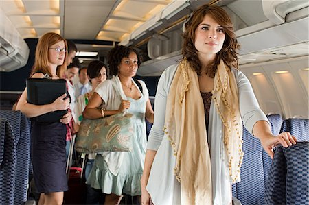Passengers boarding a plane Stock Photo - Premium Royalty-Free, Code: 6114-06599059