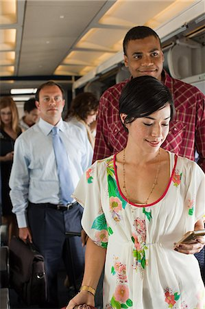 Passengers boarding a plane Stock Photo - Premium Royalty-Free, Code: 6114-06599098