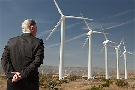 Businessman on a wind farm Stock Photo - Premium Royalty-Free, Code: 6114-06599112