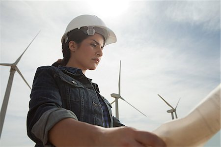 Female engineer at wind farm with plans Stock Photo - Premium Royalty-Free, Code: 6114-06599114