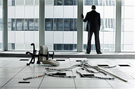 Businessman in abandoned office Stock Photo - Premium Royalty-Free, Code: 6114-06599389
