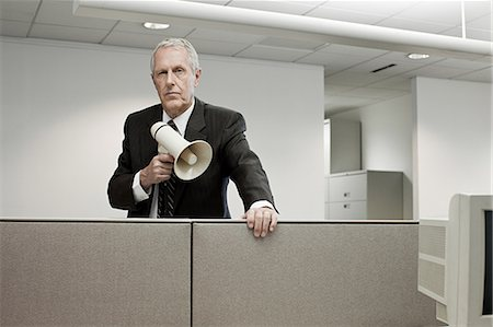 Businessman with megaphone Stock Photo - Premium Royalty-Free, Code: 6114-06599434