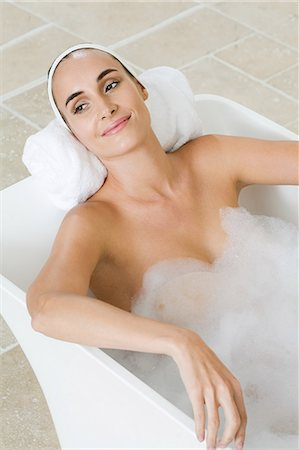 Young woman relaxing in the bath Stock Photo - Premium Royalty-Free, Code: 6114-06599660
