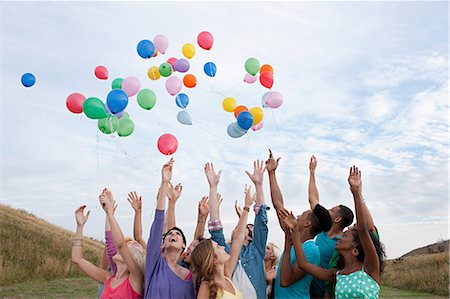 release - Young people releasing balloons Stock Photo - Premium Royalty-Free, Code: 6114-06599779