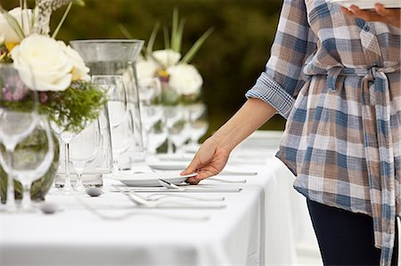 placing - Woman preparing table for dinner party in a field Stock Photo - Premium Royalty-Free, Code: 6114-06599854